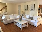 Living room with plenty of space - don't fear white couches, covers are machine washable!