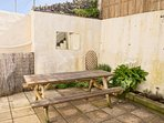 Sheltered courtyard garden with BBQ