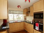 Refitted kitchen with integrated appliances.
