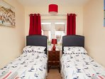 Twin bedroom with dual aspect river views - looks over Wroxham Bridge.