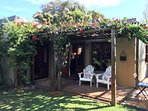 Beautiful bougainvillea covered patio in tranquil garden