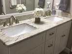 Master Bathroom with dual sinks and granite countertop