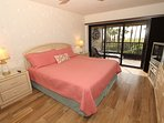 Master bedroom - King size bed, glass doors open to lanai/porch