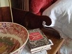 Antique furniture and vintage books for quiet nights at the open fire