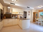 Fully equipped breakfast kitchen and Laundrette with table for 6 persons.
