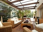 Conservatory with fold away windows.