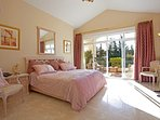 Master bedroom with supper king size bed ; leading to  upper terrace.