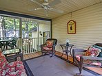 The covered porch is ideal for a relaxing evening spent with loved ones.