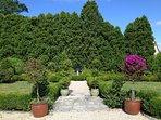 Parterre box garden and a serpentine perennial garden behind 18th century dry-laid fieldstone walls.