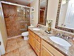 NEW! Master bathroom with beautiful new shower and double vanity.