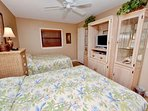 Guest bedroom 1 with 2 Queen size beds and flat screen TV