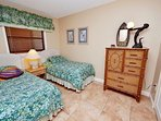 Guest bedroom 2 with 2 twin size beds.