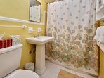 Bathroom with safety rail and tub/shower combo