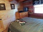 Queen Log Bed in Room with TV