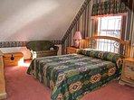 Queen bed in upper level