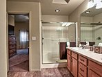 The spacious shower offers sliding glass doors to climb into.