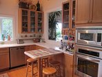 Built-in oven and microwave plus breakfast area.