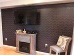 living room focal wall with electric fireplace