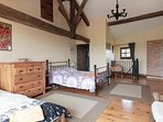 Master bedroom with en-suite ,single bed and a double . French doors withJuliet balcony.