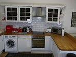 kitchen dishwasher washer dryer hob oven microwave kettle coffee machine