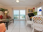 Living Room and big balcony with white beaches and Gulf of Mexico.