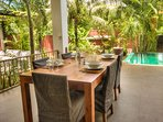 terrace with dinner table by the pool