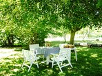 So many areas to enjoy al fresco dining on the property. Have breakfast here in the orchard