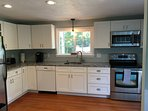 Brand new kitchen with granite counters and stainless appliances