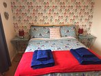 double bed light airy room  with wardrobe and chest of drawers