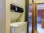The full size stackable washer and dryers are located just between the kitchen and guest bath.