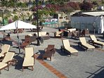 Plenty of sun loungers at the communal swimming pool.