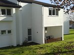 Front door, tiny square of garden, primroses in Spring, west patio sun trap furnished,
