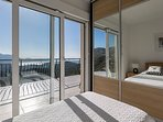 Twin room with built-in wardrobes, opening on to the balcony. A/C