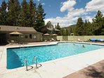 Take A Swim Then Relax Around The Year Round Heated Pool. The Condo Can Be Seen Past The Umbrellas.