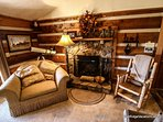 The interior of this home is decorated with log furniture and mountain artifacts. The wood burning fireplace adds the...