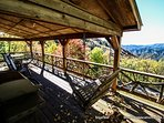 Sit on the 20 foot covered porch and watch the stunning sunset over the Appalachian Mountains or on a cool evening have...