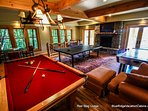 Just below the main floor is the large game room which features a plethora of entertainment options, including...