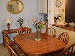 Dining Table opens and has 8 chairs