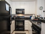Kitchen has all the small appliances for gourmet cooking, granite tile work, and dishwasher.