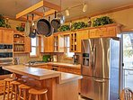 The hanging pots & pans add charisma to the rustic updated kitchen.