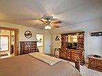 Gorgeous rustic decor enhances the master bedroom.