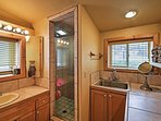 Freshen up for the day in this clean bathroom with a sleek walk-in shower.