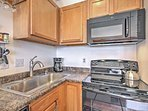 The kitchen is fully equipped to handle all of your culinary concoctions.