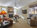 Living Room with Fireplace and custom wall-mounted 55' Smart TV HBO and Netflix provided
