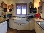 Great, characterful kitchen with range oven, double sink, large fridge, drinks fridge, dishwasher