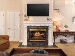 The fireplace will keep you warm after a long day on the slopes.
