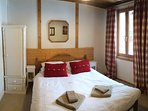 Double bedroom with en-suite shower and views to nearby wooded hillside and meadows