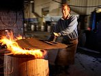 Watch barrels getting charred before their next filling with Whisky at the nearby Speyside Cooperage