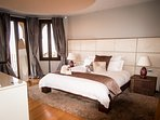 Master Bedroom with queen sized extremely comfy bed, & Egyptian cotton sheets, + balcony with views.