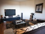 Media room with 60' TV, surround sound, DVD, BluRay, Ps3, Wii & an extensive DVD/ BluRay/CD library.